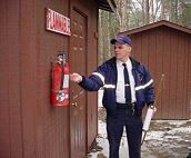 Inspection Division Looking at Extinguisher